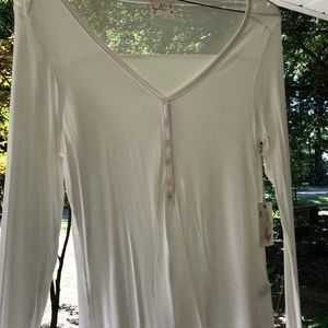 Long-sleeved white shirt with sheer panel on back